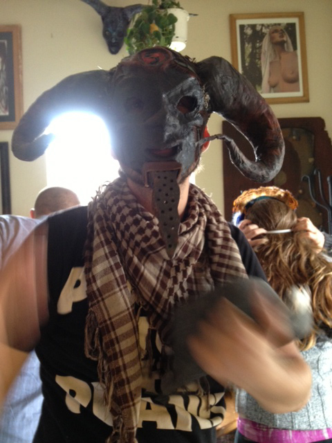 person in a horned mask