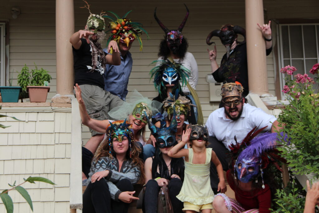 group of masked people on a porch