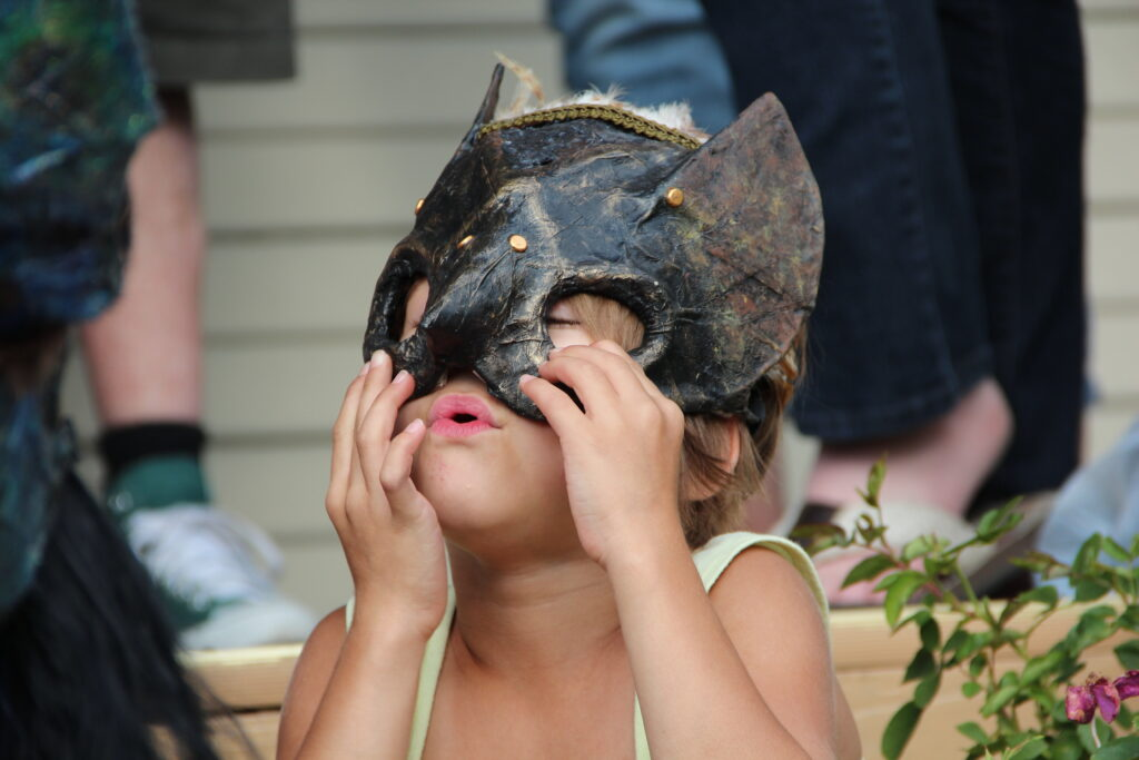 child in a mask
