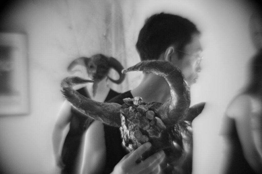performer holding mask