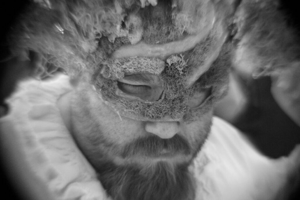 masked performer close up