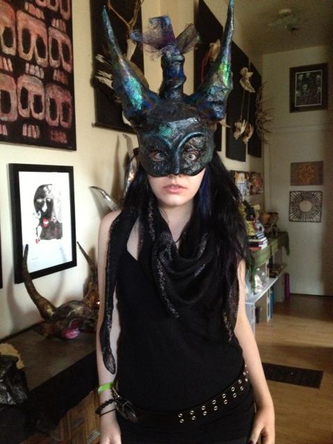 woman in a devil mask